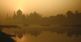 The Taj Mahal along the Yamuna river at sunrise