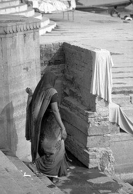 Woman walking along the ghats of Varanasi India