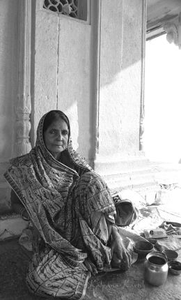 Woman sitting in front of her house in Varanasi India