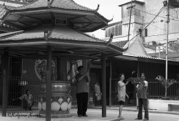 Freeing birds at the oldest Chinese temple Chinatown Jakarta Indonesia