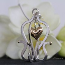 =SILVER CAGE WITH GOLDEN HEART=
