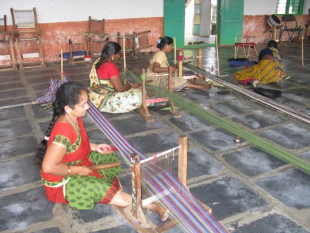Loom set up and warp tied at each end during weaving