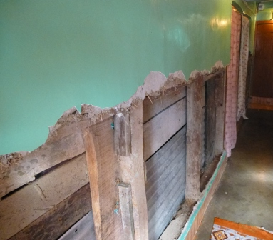 Flood damaged walls in Shabir's home