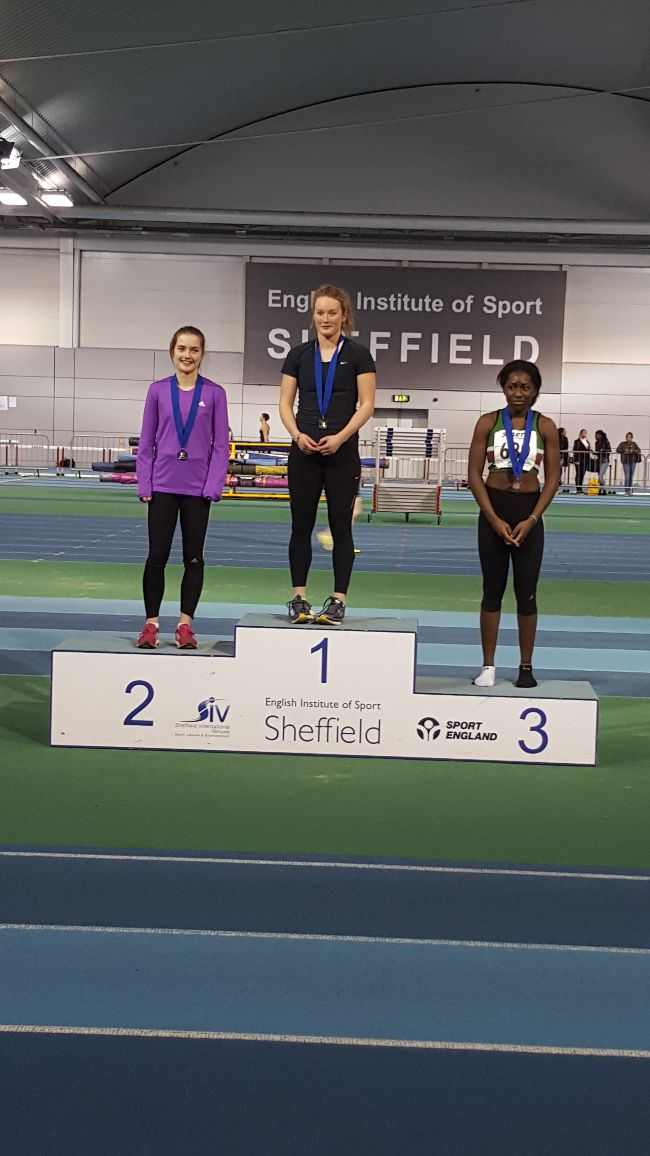 Lily receiving her gold medal
