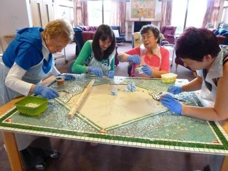 Sue Kershaw with clients from Trafford Macmillan Care Centre working on the Hope mosaic commission
