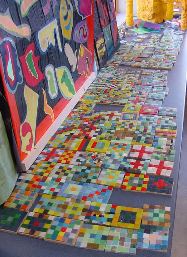 Mosaic coasters created with primary school children during York Live Arts week funded by York City Council