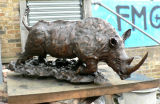 Charging White Rhino During Patination. Edition of 3. 56Lx22Wx25cmH £4500