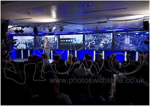 Chris Dedicoat and 5 x 103 inch plasma screens