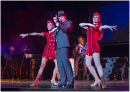 Roman Marek as Frank Sinatra with Vegas Showgirls