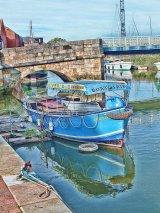 Boat on the River Stour beneath the Toll Bridge, Sandwich, Kent