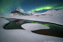 """Reflecting beneath the Aurora"""