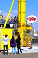 3 people looking at the Booster Ride