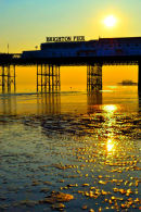 Brighton Pier, sand and sunset from beach