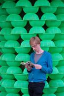 Chris Reading Against Green Bowl Sculpture