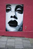Portrait Graffiti on Pink Wall