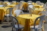 yellow clothes and white chairs