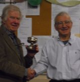 Ray McKenna receiving Rosebowl From Arthur Kingdon