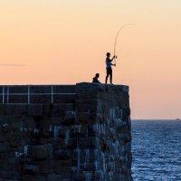 Fishing at sunset, Jersey