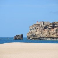 White sand, high cliffs, blue skies