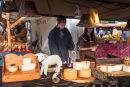 Cheeseseller at Market