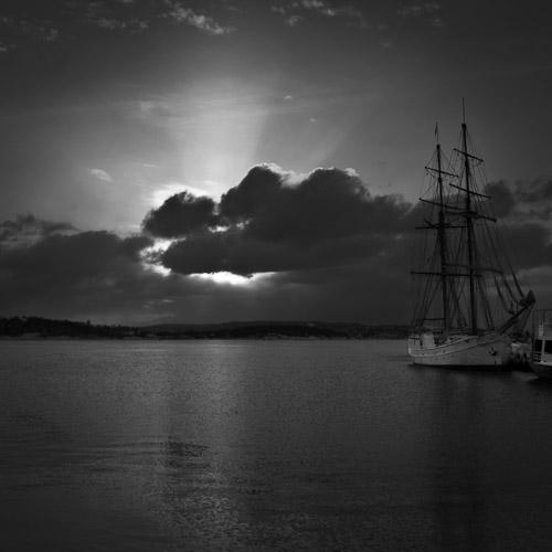 Sail ship under a low Sun