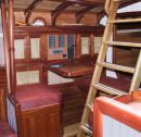 All interior surfaces and furniture comprise a variety of hardwoods
