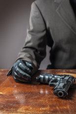 anonymous-man-with-gun-©benjaminharte