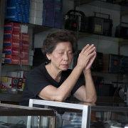 Woman praying, Bangkok, Thailand