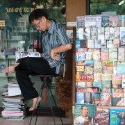 Newsagent seller, Bangkok, Thailand