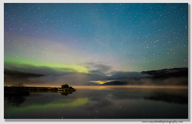 Aurora and the night sky over Loch Ness