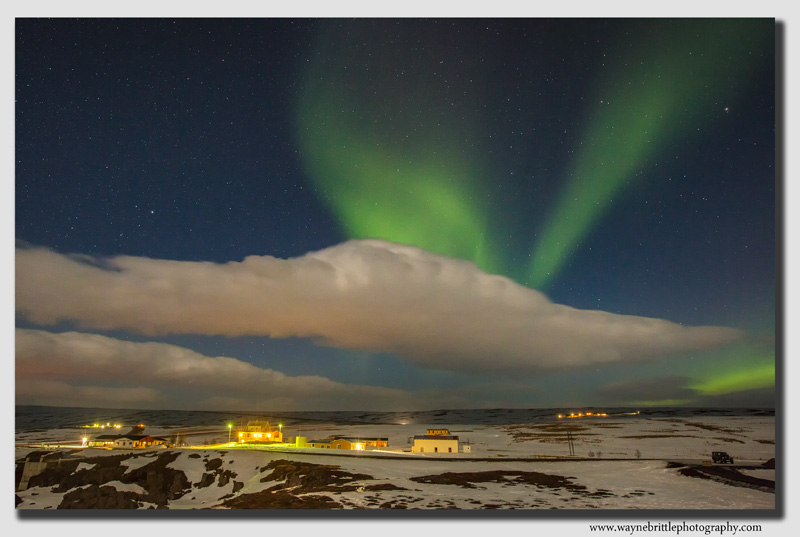 Aurora over Icelandic dwellings