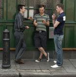 3 men outside a pub