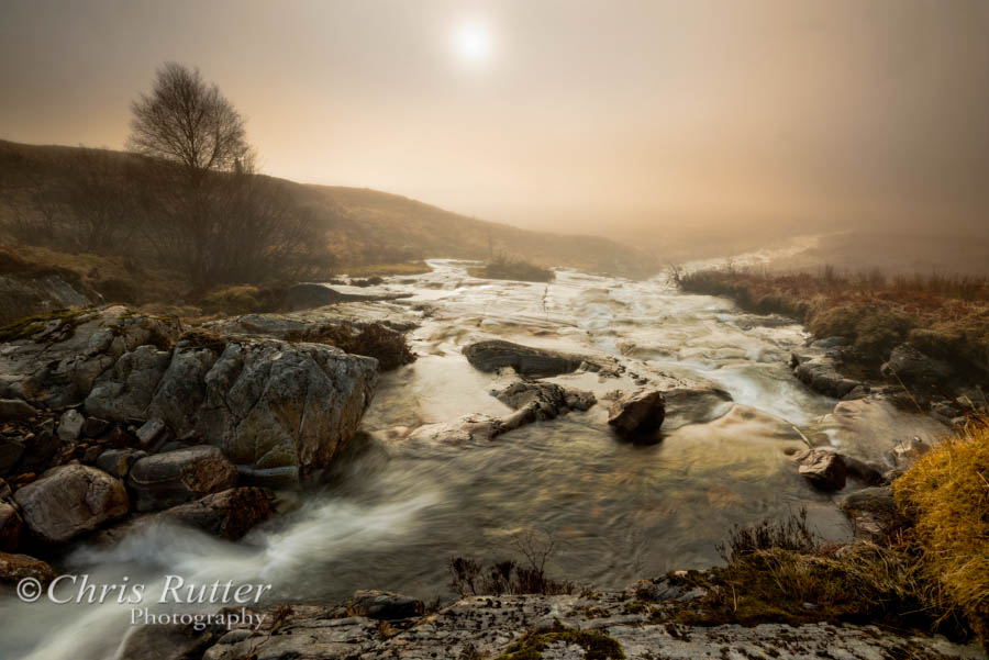 Misty waterfall near Loch Cluanie