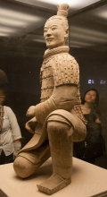 A kneeling life-size archer warrior