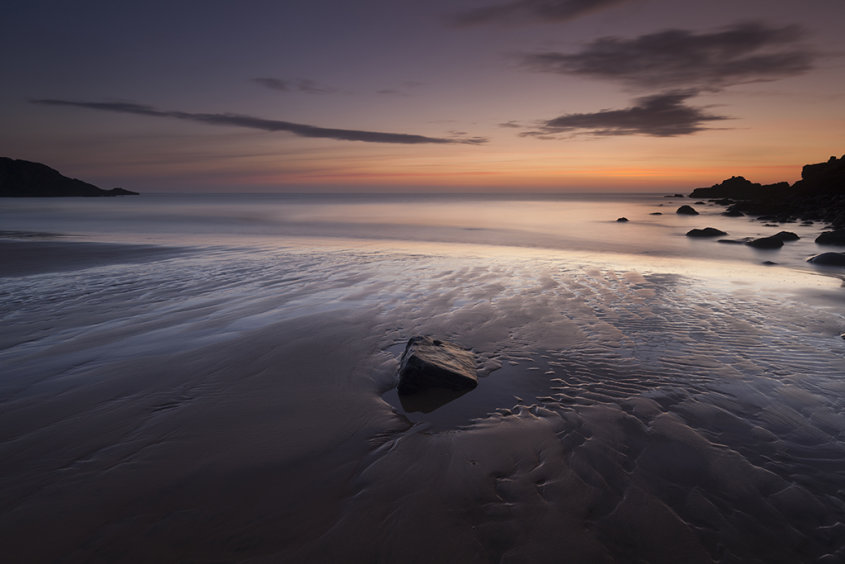 rock in the sand, hackley bay