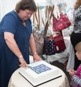Lacey Street, Sarah cutting the CWK stamp cake