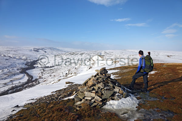 01D-9627 Hill Walker Enjoying the View up Arkengarthdale From Fremington Edge in Winter Arkengarthdale North Yorkshire.
