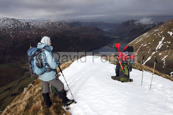01D-9743 Walkers on Rough Edge in Winter with the View Towards Brotherwater and Ullsawater Caudale Moor Lake District