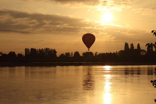 02D-5637 Hot Air Balloon Flying Over the Town of Les Rosiers Sur Loire Just After Sunrise With the Loire River in the Foreground France