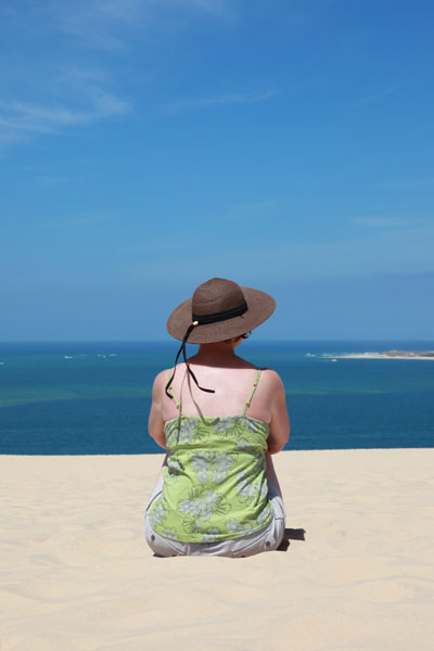 02D-5856a Woman Wearing a Sunhat and Enjoying the View on the Dunes du Pyla Near Arachon France
