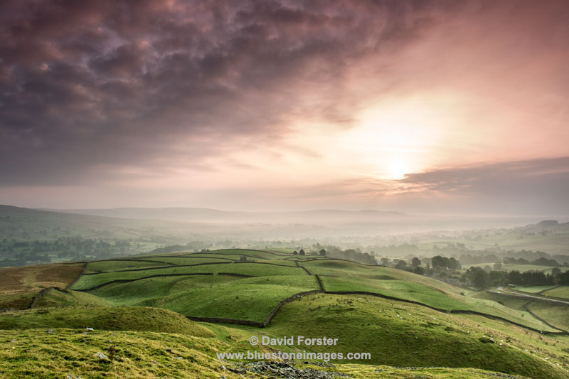 The View Across a Misty Teesdale at Sunrise From the Ancient Tumulus of Kirkcarrion, Lunedale, County, Durham England.