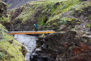 03D-5656 Hiker on the Bridge Crosssing the Canyon of the Syori-Emstrua on the Laugavegurinn Hiking Trail Iceland