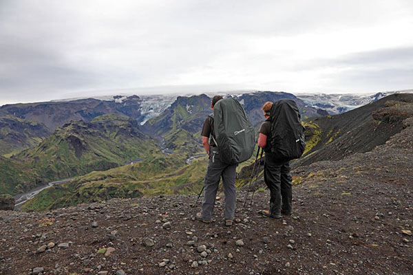 03D-5829 2 Hikers on the Kattarhryggir Ridge in Gooaland Looking Towards the Katla Volcano Which is Covered by Myrdalsjokull Glacier Iceland.