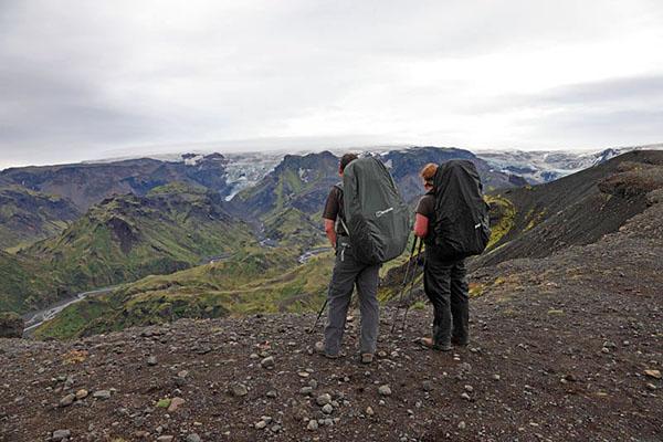 03D-5829 2 Hikers on the Kattarhryggir Ridge in Gooaland Looking Towards the Katla Volcano Which is Covered by Myrdalsjokull Glacier Iceland.