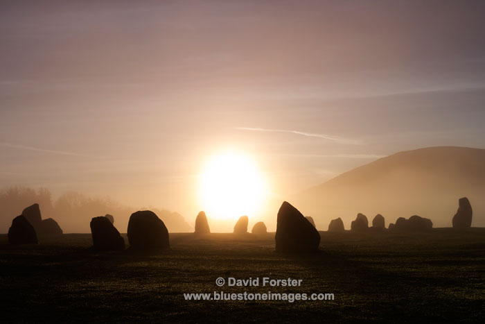 03M-2862a Sunrise Diffused by Early Morning Mist at the Castlerigg Stone Circle Lake District Cumbria UK