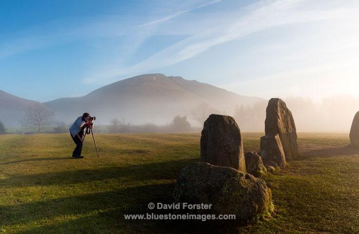 03M-2962 Photographer Photographing the Castlerigg Stone Circle Near Keswick Lake District Cumbria UK