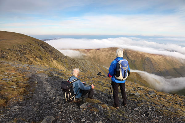 04D-0637 Two Walkers Watching People Scrambling Along Sharp Edge on Blencathra With Clouds Below Lake District Cumbria