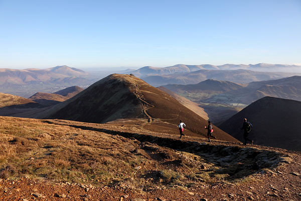 04D-2037 Three Runners and the View NE from the Slopes of Sail Towards the Summit of Causey Pike Blencathra and the Helvellyn Range Lake District Cumbria.