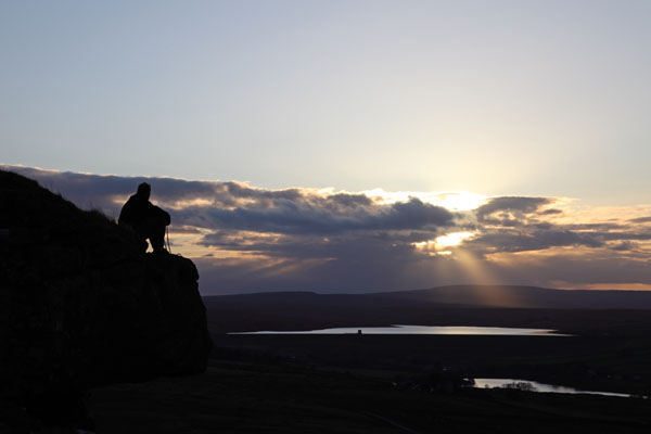 04D-7074 Rock Climber on Goldsborough Crag at Sunset with the Reservoirs of Balderhead and Blackton Behind Baldersdale Teesdale County Durham UK