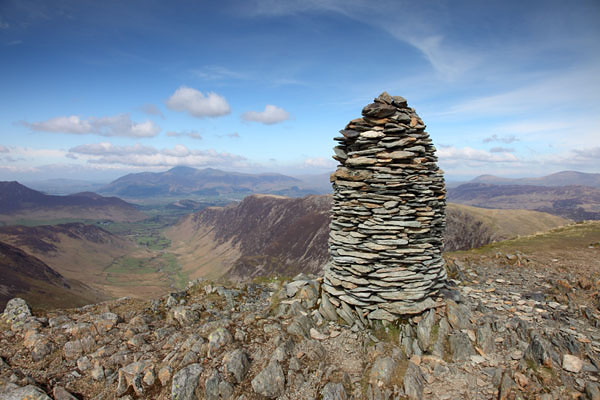 04D-7381 The Summit Cairn of Dale Head and the View Down the Newlands Valley Towards the Mountain of Skiddaw Lake District Cumbria UK